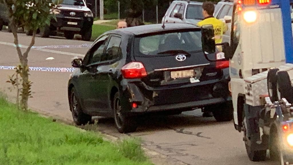 Four cars were towed from the scene, including this damaged Toyota Corolla.