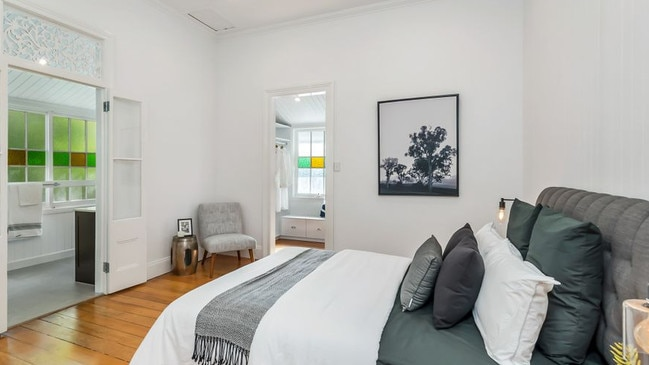 The bedroom has classic features, from detailed fretwork to VJ walls.