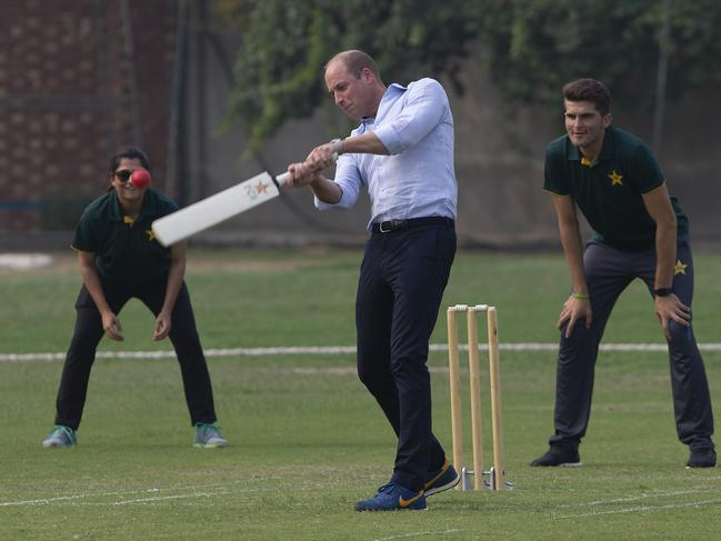 Prince William got stuck into the action as well as Pakistani bowler Shaheen Afridi and captain of Pakistani women cricket team Sana Mir look on. Picture: AP Photo/B.K. Bangash