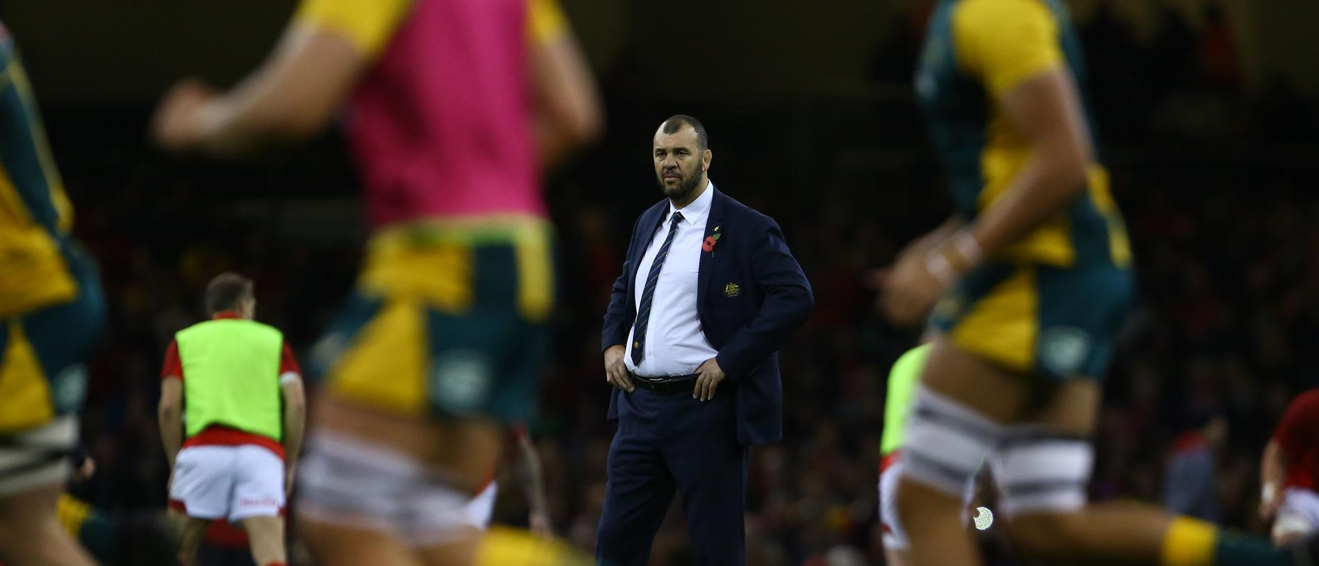 Australian head coach Michael Cheika watches warm up before the international rugby union test match between Wales and Australia at the Principality stadium in Cardiff, south Wales, on November 10, 2018. (Photo by GEOFF CADDICK / AFP) / RESTRICTED TO EDITORIAL USE -use in books subject to Welsh Rugby Union (WRU) approval