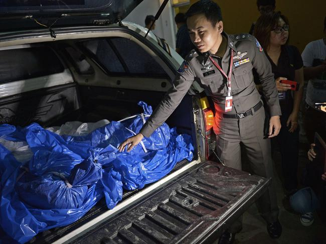 Being transported ... the bodies of the victims are due to arrive in Bangkok later on Tuesday for forensic tests.