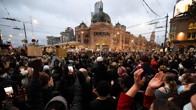 Protesters rallied outside Flinders Street railway station in Melbourne. Picture: AAP/James Ross