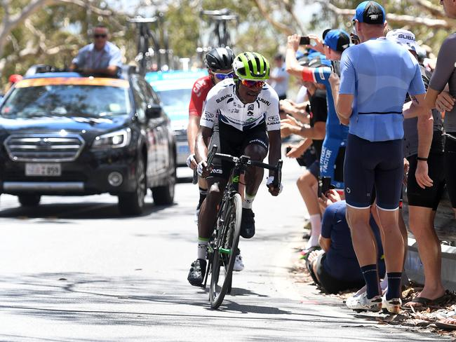 South African rider Nicholas Dlamini climbs Willunga Hill to retain his King of the Mountain jersey.