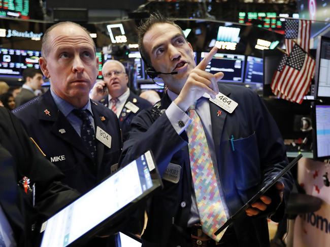 Traders work on the floor of the New York Stock Exchange on April 25 where Microsoft shares topped estimates. Picture: AP Photo/Richard Drew, File