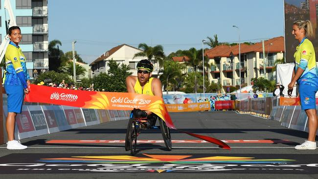 A spent Kurt Fearnley crosses the finish line more than a minute ahead of his nearest rival. Picture: Getty Images