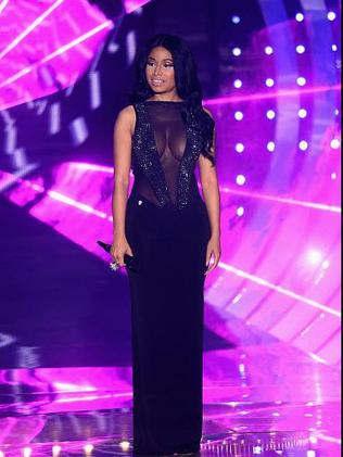 Minaj also showed off her assets in a black evening gown.