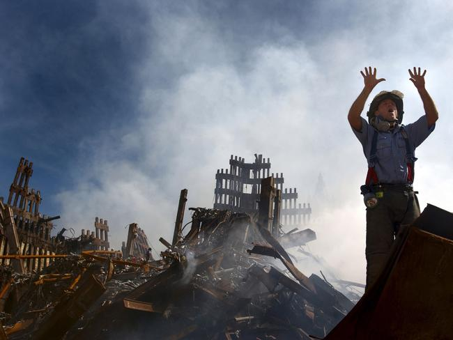 A New York City fireman calls for 10 more rescue workers to make their way into the rubble of the World Trade Centre. Picture: Alamy