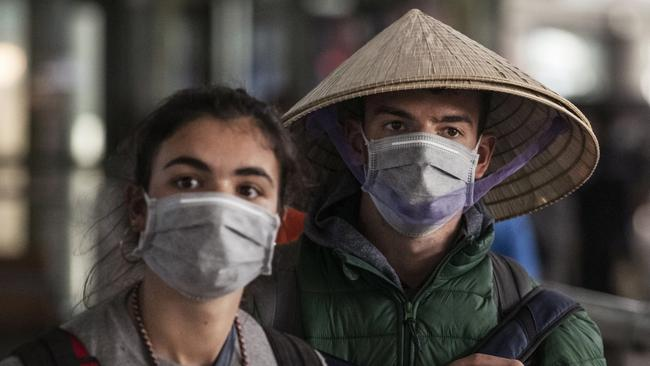 Foreign tourists at Beijing Capital Airport on January 30. Picture: Kevin Frayer/Getty Images)