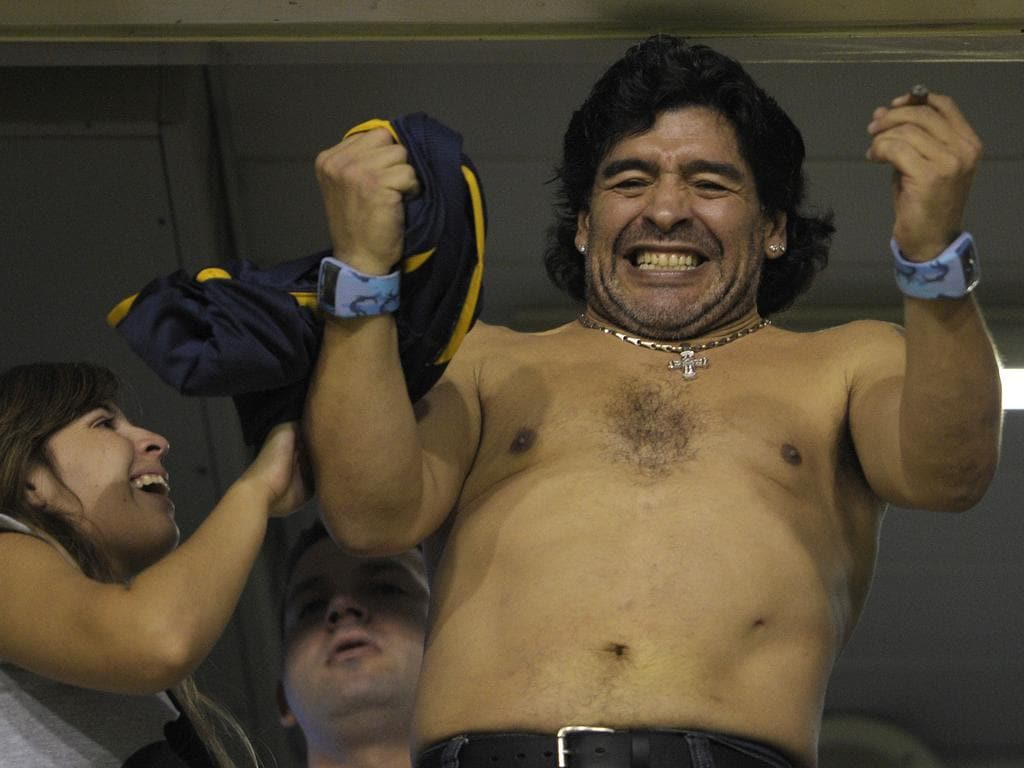 Argentine former footballer Diego Maradona (R) celebrates with his daughter Dalma after Boca Juniors defeated 3-0 Venezuela's UA Maracaibo in their Libertadores Cup football match, at La Bombonera stadium in Buenos Aires on April 22, 2008. AFP PHOTO/Juan Mabromata