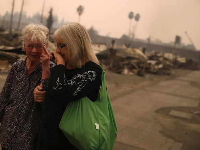 Residents walk through the fire damaged Journey's End Mobile Home Park in Santa Rosa, California. Picture: Justin Sullivan/Getty