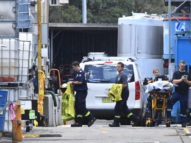 Emergency services respond to an industrial accident on Chisholm Street in Auburn, Sydney. Picture: AAP