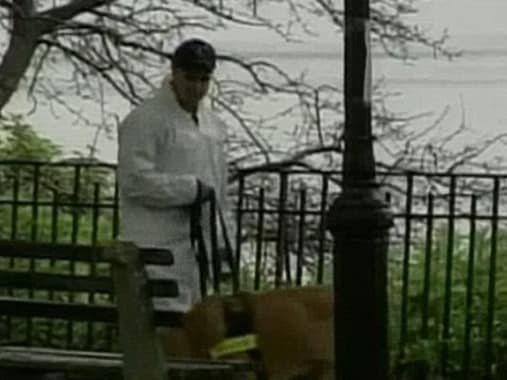 An investigator looks for clues at the crime scene at the time of Sarah's death.