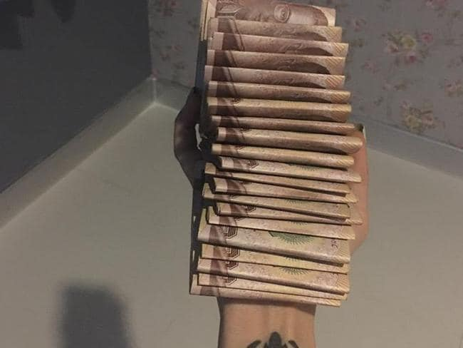 "A wad of cash posted by ""Preaw"" on her Facebook page."