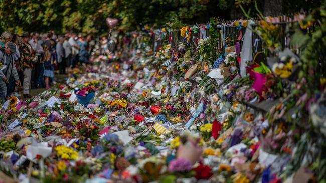 People view flowers and tributes by the botanical gardens in Christchurch. Picture: Carl Court/Getty Images
