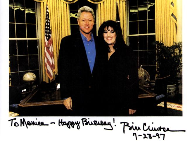 Then-President Bill Clinton with former White House intern Monica Lewinsky in the Oval office in a photograph given by the President to her as a birthday gift in 1997.
