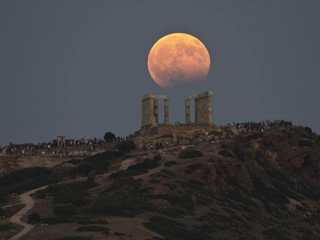 The August full moon rises above the 5th Century BC Temple of Poseidon at Cape Sounio, south of Athen. Picture: AP