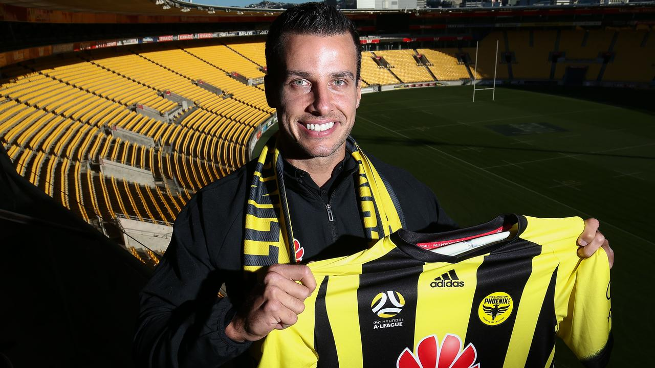 New Phoenix signing and former Newcastle United player Steven Taylor poses during a Wellington Phoenix player announcement.