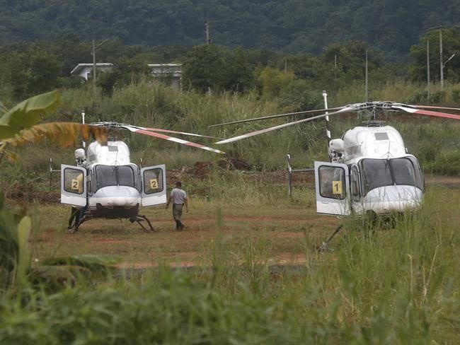 Two helicopters wait near the cave for more evacuations. Picture: Sakchai Lalit/AP Photo