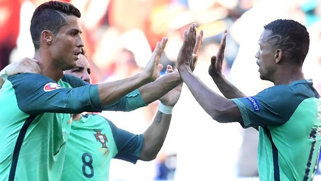 Portugal's forward Nani (R) is congratulated by Portugal's forward Cristiano Ronaldo.