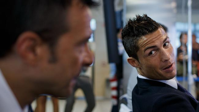 Crsitiano Ronaldo (R) speaks with his agent Jorge Mendes (R).