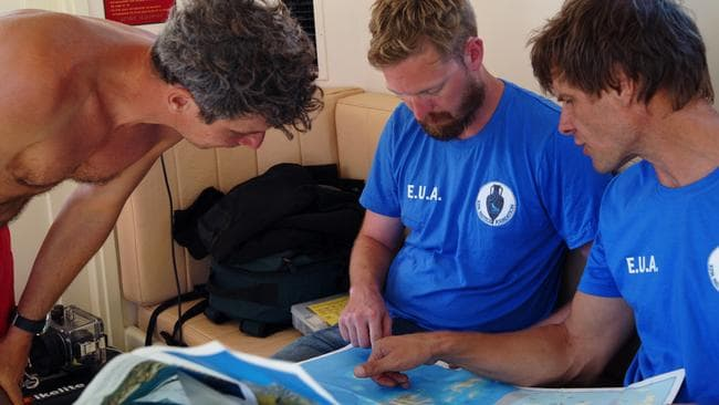 Directors Goerge Koutsouflakis and Peter Campbell examine maps of the archipelago. Source: V. MENTOGIANIS / PHOURNOI UNDERWATER SURVEY