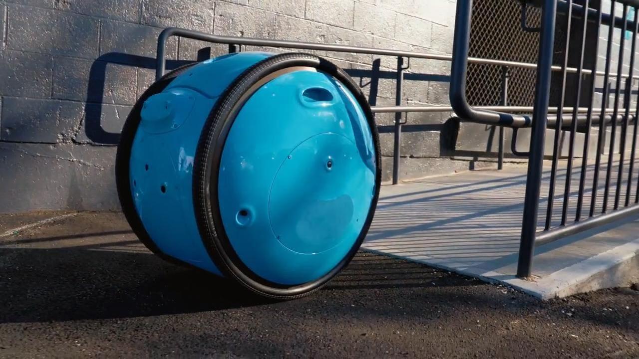 Team behind Vespa scooter design robotic luggage