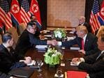 US President Donald Trump (3rd R) shakes hands with North Korea's leader Kim Jong Un (3rd L) as they sit down with their respective delegations for the US-North Korea summit, at the Capella Hotel on Sentosa island in Singapore on June 12, 2018. Picture: AFP PHOTO / SAUL LOEB