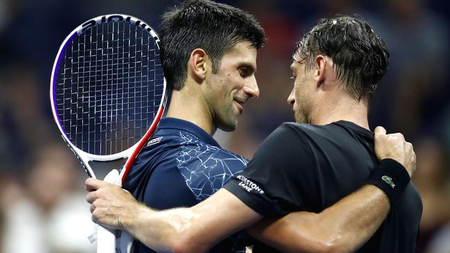 Novak Djokovic of Serbia hugs John Millman of Australia after their men's singles quarter-final match. Picture: Getty Images