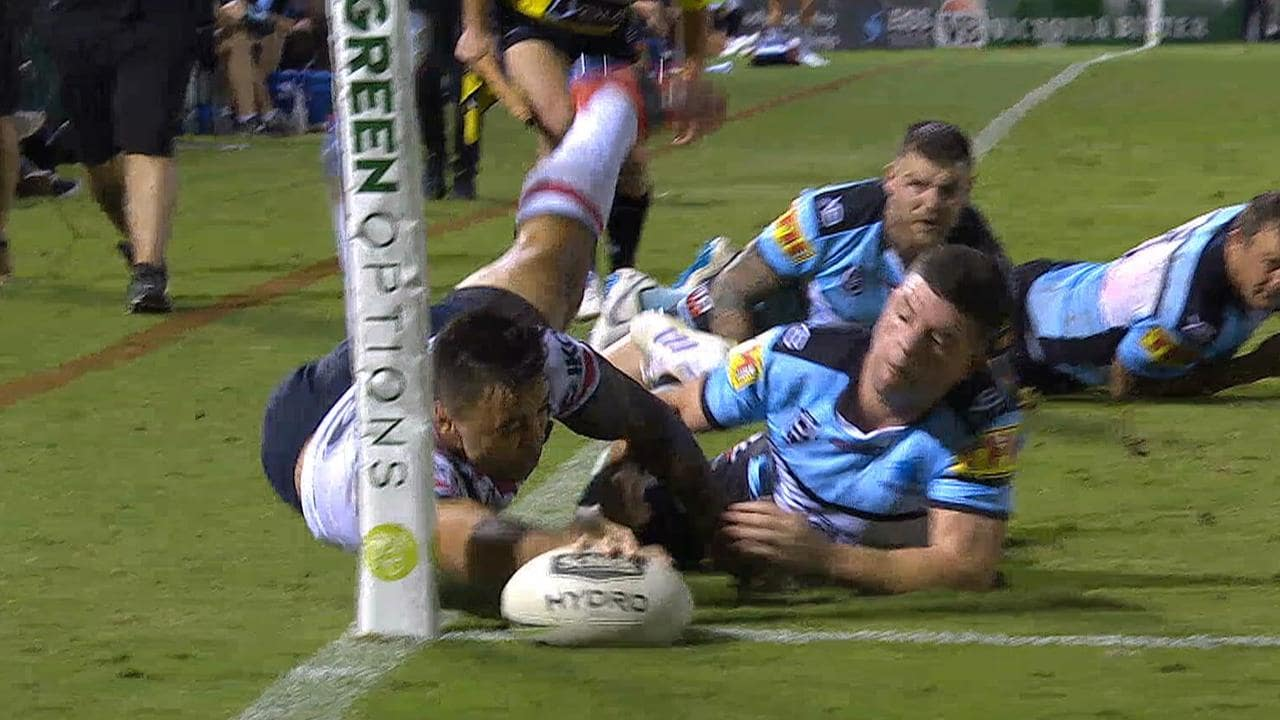 Matt Ikuvalu scores an inch perfect try in the corner against the Sharks.