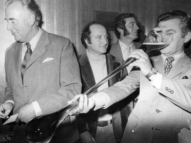 Bob Hawke (R) drinking a yard of ale at the official opening of the Bob Hawke Hotel. Picture: Supplied