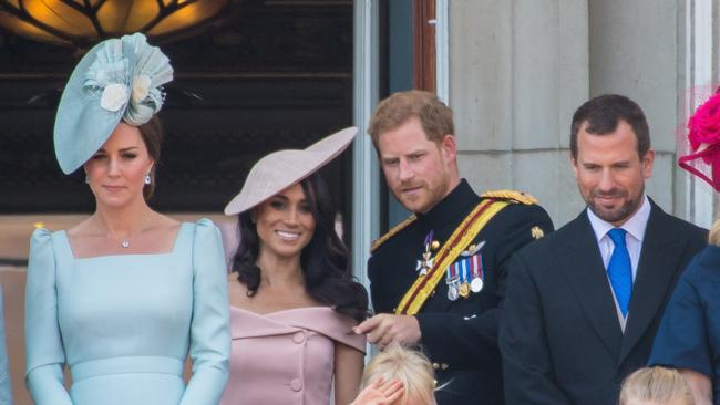 Lip-reading experts reported Prince Harry guiding Meghan Markle throughout the event. Picture: MEGA