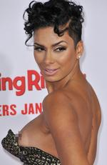"Going... ""Basketball Wives"" Star Laura Govan has a wardrobe malfunction on the red carpet at ""The Wedding Ringer"" Los Angeles premiere. Picture: Splash News"