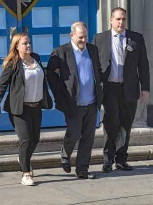 Weinstein was led from the police station in handcuffs and flanked by officers. He is due to appear in court later this morning. Photo: MEGA