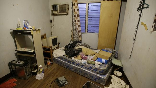 A room inside the home of suspected child webcam cybersex operator, David Timothy Deakin. Children's underwear, toddler shoes, cameras, bondage cuffs, fetish ropes, meth pipes, stacks of hard drives and photo albums cluttered the stuffy, two-bedroom townhouse. Picture: AP/Aaron Favila