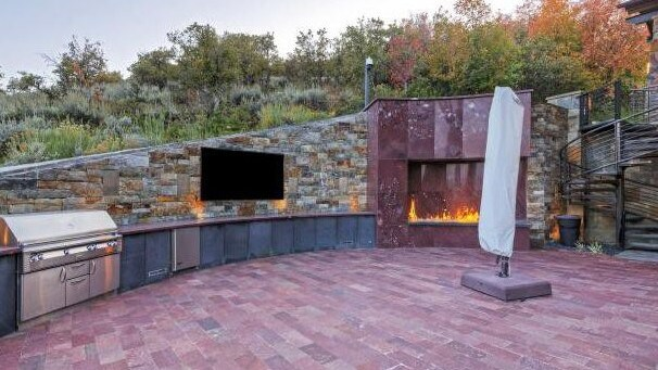 The huge outdoor entertaining area with big screen to watch the game while barbecuing. Picture: Realtor