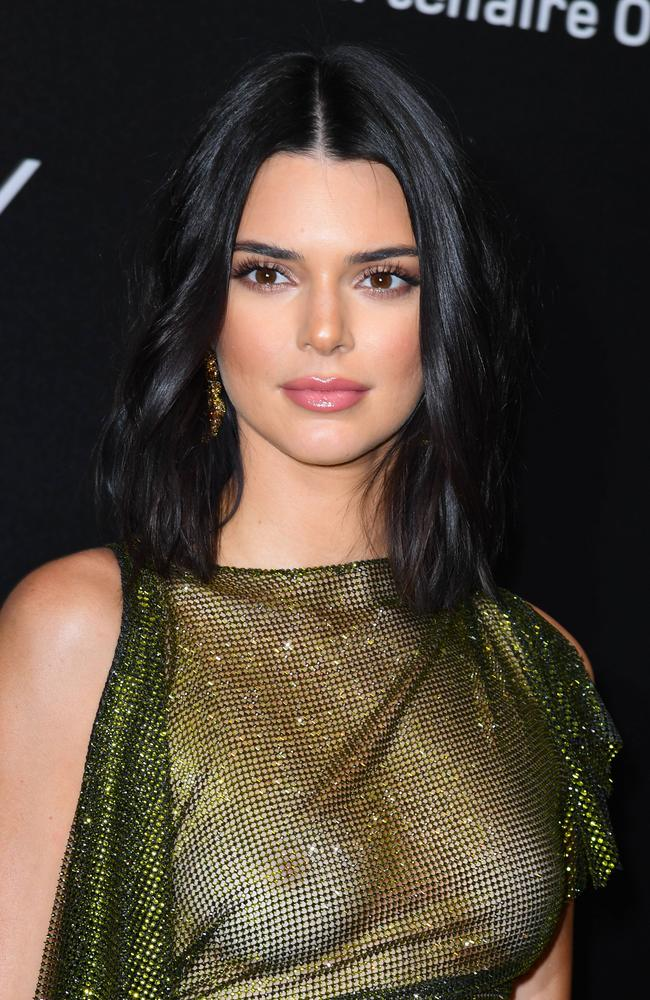 She went for a simple beauty look with a nude lip and tousled beach waves to accompany the racy look. Picture: KCS Presse / MEGA