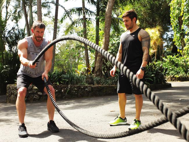 Chris Hemsworth works out with Luke Zocchi.