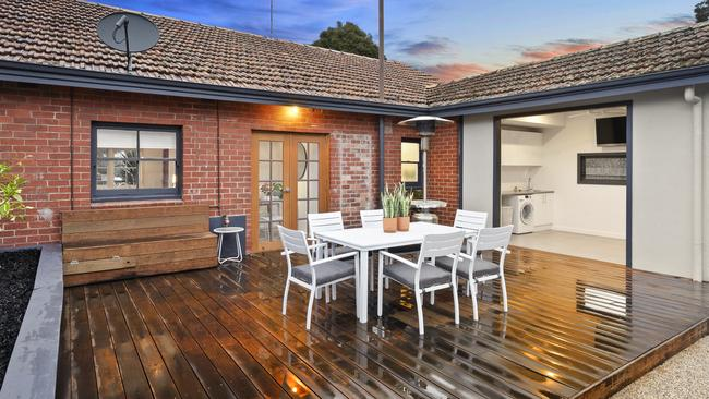 14 Churchill Ave, Newtown sold for $516,000 after auction. The house has been fully renovated, including a sleek new kitchen and bathroom and outdoor barbecue room.