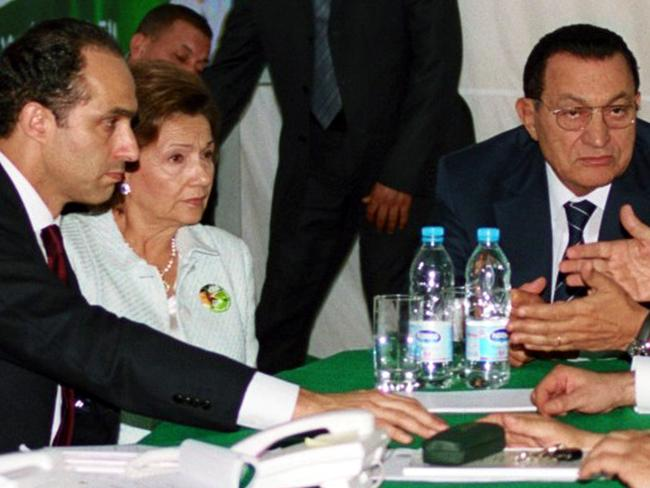 A file photo taken on September 07, 2005 shows Egyptian President Hosni Mubarak (R) monitoring election results with his wife, Suzanne, and younest son, Gamal (L). Picture: AFP