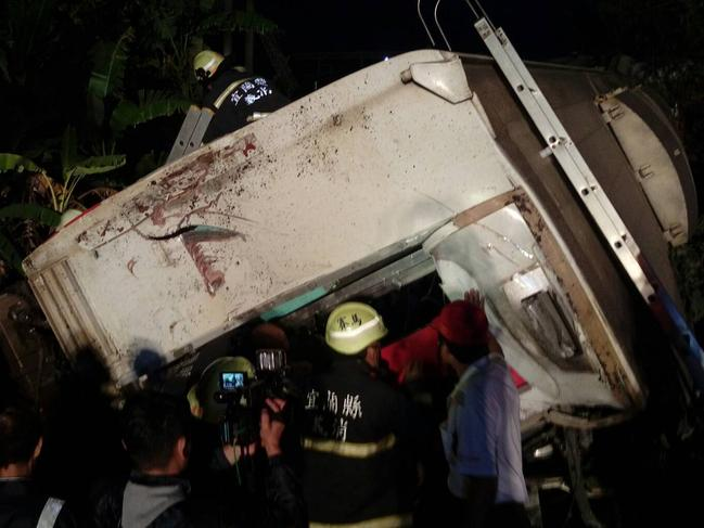 At least 22 people have died after a train derailed and flipped over in Taiwan, authorities said. Picture: AFP