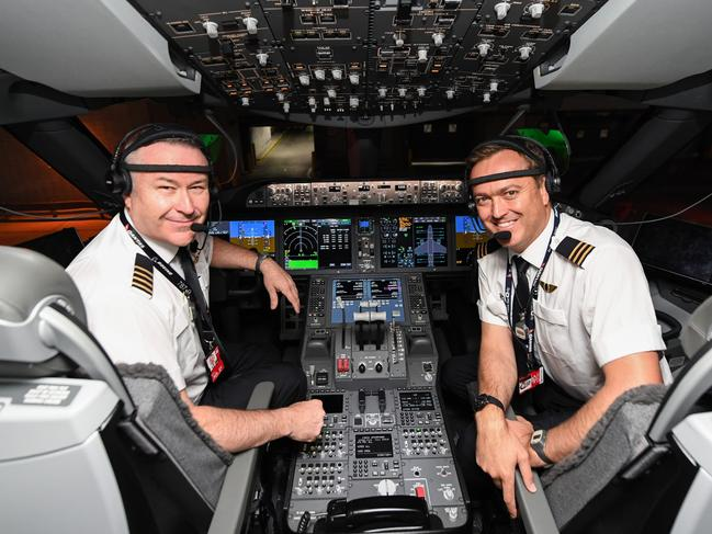 Captain Sean Golding (left) and first officer Jeremy Sutherland prepare to fly to Australia on October 18, 2019 on the flight from New York to Sydney. Picture: James D. Morgan/Getty Images for Qantas.