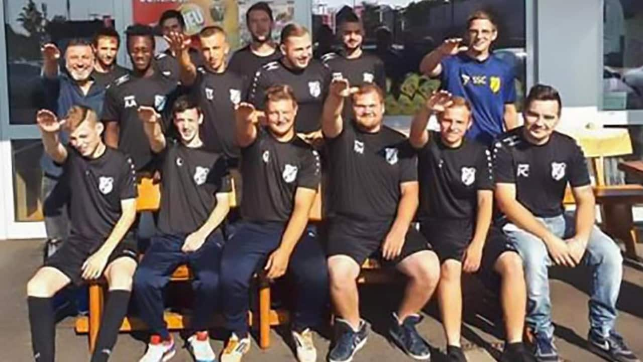Players from German side SC1920 Mhyl's second team perform 'Nazi salutes' in a team photo.