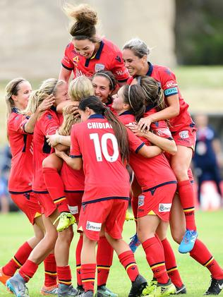 The Reds celebrate Makenzy Doniak's third goal in Adelaide United's win over Perth Glory. Picture: Mark Brake/Getty Images