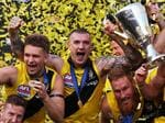 The Tiger's Dustin Martin celebrates with the Premiership Cup after Richmond defeated the Adelaide Crows in the 2017 AFL Grand Final at the MCG. picture. Phil Hillyard