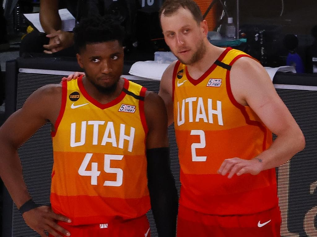 LAKE BUENA VISTA, FLORIDA - AUGUST 23: Joe Ingles #2 of the Utah Jazz and Donovan Mitchell #45 of the Utah Jazz talk during the fourth quarter in Game Four of the Western Conference First Round against the Denver Nuggets during the 2020 NBA Playoffs at AdventHealth Arena at ESPN Wide World Of Sports Complex on August 23, 2020 in Lake Buena Vista, Florida. NOTE TO USER: User expressly acknowledges and agrees that, by downloading and or using this photograph, User is consenting to the terms and conditions of the Getty Images License Agreement.  (Photo by Kevin C. Cox/Getty Images)