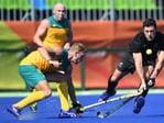 New Zealand's Kane Russell vies for the ball with Australia's Tim Deavin during the men's field hockey match of the Rio 2016 Olympics Games.