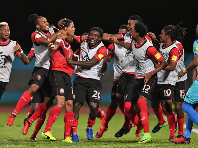 Trinidad and Tobago celebrate against America.