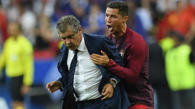 Fernando Santos and Cristiano Ronaldo celebrate at the final whistle.