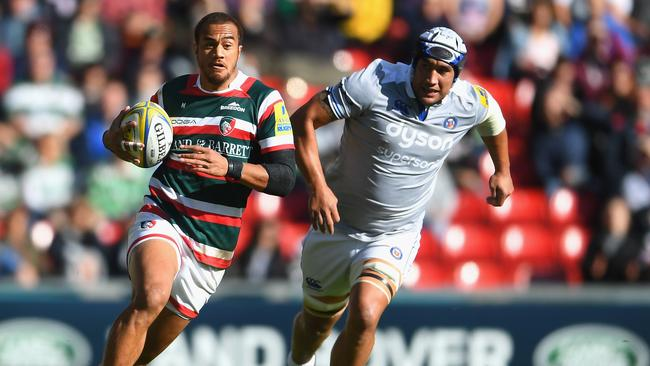 Former Wallaby Peter Betham runs away from Bath and Reds No 8 Leroy Houston.