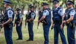 CHRISTCHURCH, NEW ZEALAND - MARCH 18: Police officers carrying automatic rifles guard the area near Al Noor mosque during a visit by Turkey's Vice-President Fuat Oktay and Foreign Minister Mevlut Cavusoglu on March 18, 2019 in Christchurch, New Zealand. 50 people were killed, and dozens are still injured in hospital after a gunman opened fire on two Christchurch mosques on Friday, 15 March. The accused attacker, 28-year-old Australian, Brenton Tarrant, has been charged with murder and remanded in custody until April 5. The attack is the worst mass shooting in New Zealand's history. (Photo by Carl Court/Getty Images)